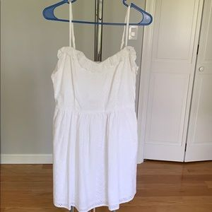 White summer dress with ruffle details.